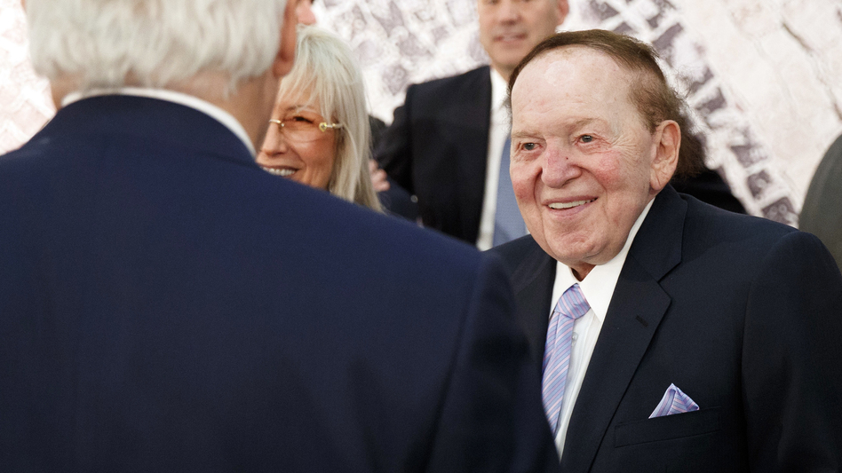 Sheldon Adelson, with his wife, Miriam, talks with then-Secretary of State Rex Tillerson before a 2017 speech by President Trump at the Israel Museum in Jerusalem. (Evan Vucci/AP)