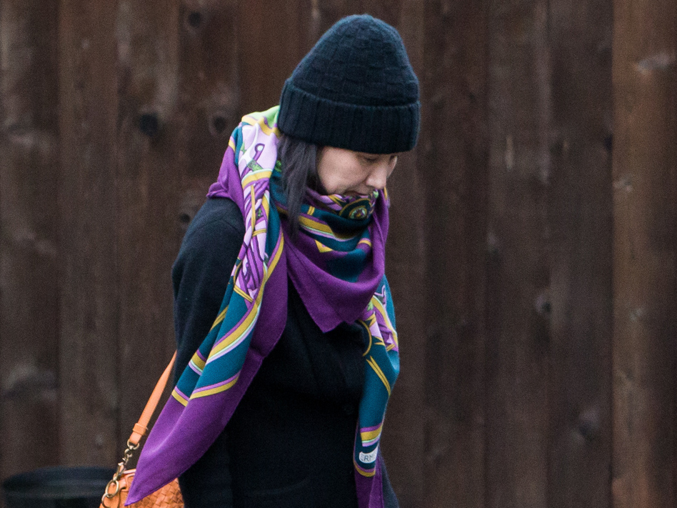 Meng Wanzhou, chief financial officer of Chinese telecom company Huawei, is seen here leaving her home under the supervision of security in Vancouver, British Columbia, in December. On Friday, Canada said that an extradition hearing in Meng's case can proceed. (Bloomberg/Bloomberg via Getty Images)