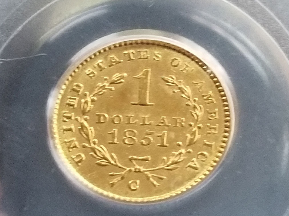 In 1849, the Charlotte mint produced a dollar coin that was just a bit different than most of its run – one with an open wreath pattern.