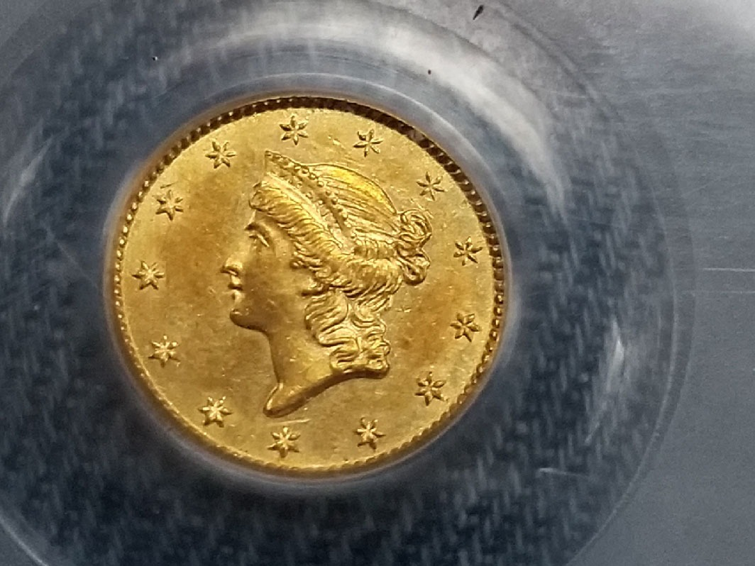A gold coin made in the Charlotte mint.