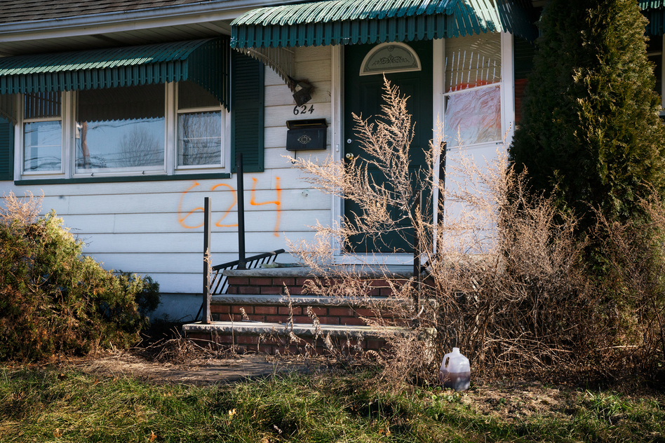 A home in the Lost Valley area of Manville, N.J. The numbers spray-painted on the front of the house indicate that it was bought as part of a federal disaster program. (Claire Harbage/NPR)