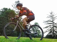 BrittLee Bowman competes during a recent cyclecross race. She was diagnosed with breast cancer and faced a decision on how to treat it.
