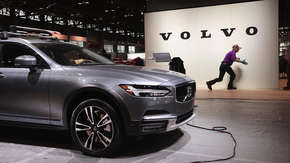 Volvo said it will limit all its new cars to a top speed of about 112 mph, starting in 2020. Here, workers on Feb. 6 prepare the Volvo display before the opening of the Chicago Auto Show. (Scott Olson/Getty Images)