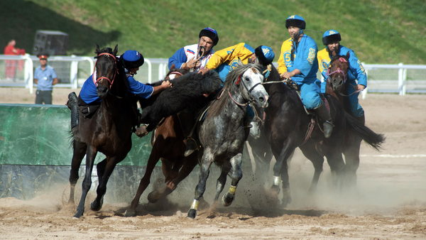 The Russian and Uzbek Kok-boru teams clash in a playoff match in the main event arena and stadium in Cholpon-Ata, Kyrgyzstan.