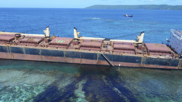 Australian officials say an environmental disaster is unfolding in the Solomon Islands after a ship ran aground and began leaking oil next to a UNESCO World Heritage site.