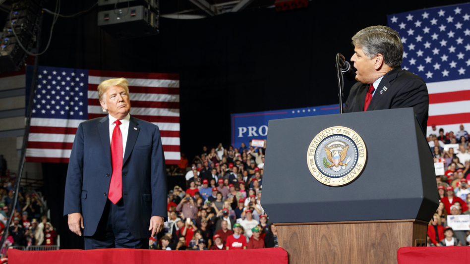 President Trump listens as Fox News host Sean Hannity speaks during a rally Nov. 5, 2018, in Cape Girardeau, Mo.
