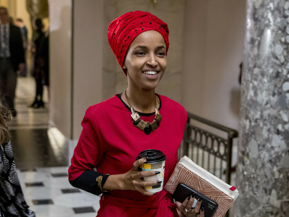 Rep. Ilhan Omar, D-Minn., walks through the halls of the Capitol Building in Washington. In Omar's Minnesota district, both Jews and Muslims voiced concern about her comments on Israel. (Andrew Harnik/AP)