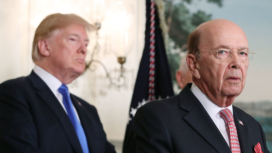 """President Trump listens as Commerce Secretary Wilbur Ross, who oversees the census, speaks at the White House. Ross approved including in the 2020 census the question, """"Is this person a citizen of the United States?"""" (Mark Wilson/Getty Images)"""