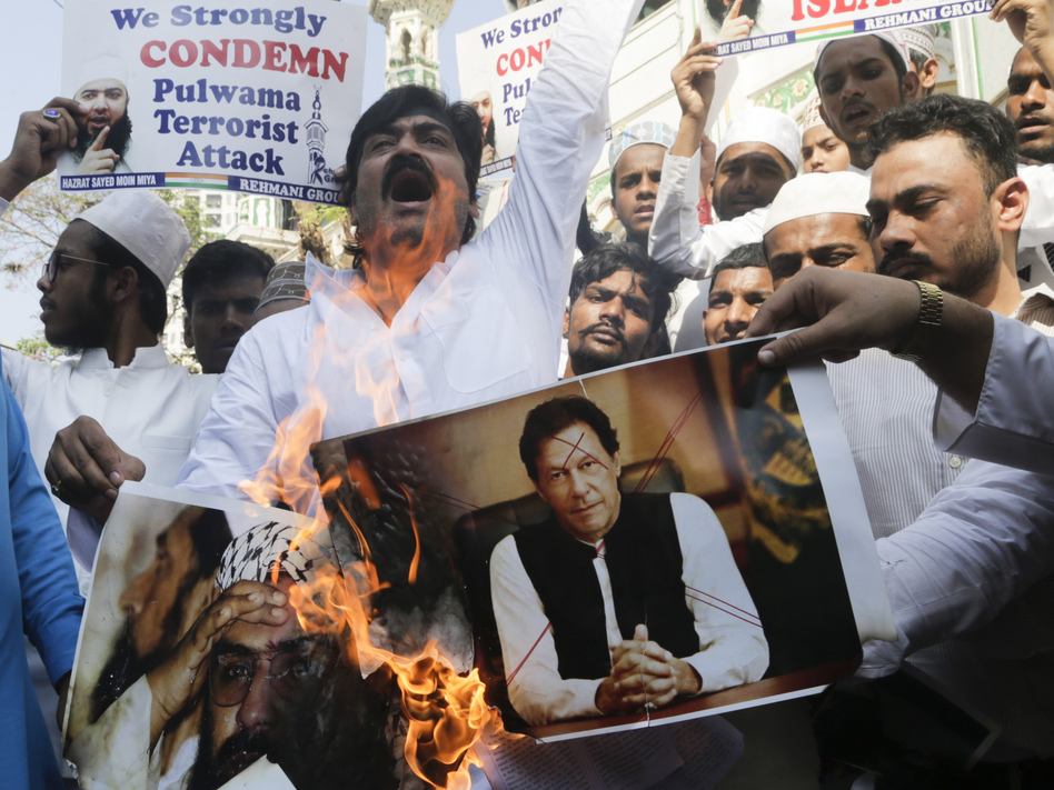 Indian protesters in Mumbai burn posters of Pakistan's Prime Minister Imran Khan during a demonstration against the Feb. 14 attack that killed more than 40 Indian policemen in the Kashmir region. (Rajanish Kakade/AP)