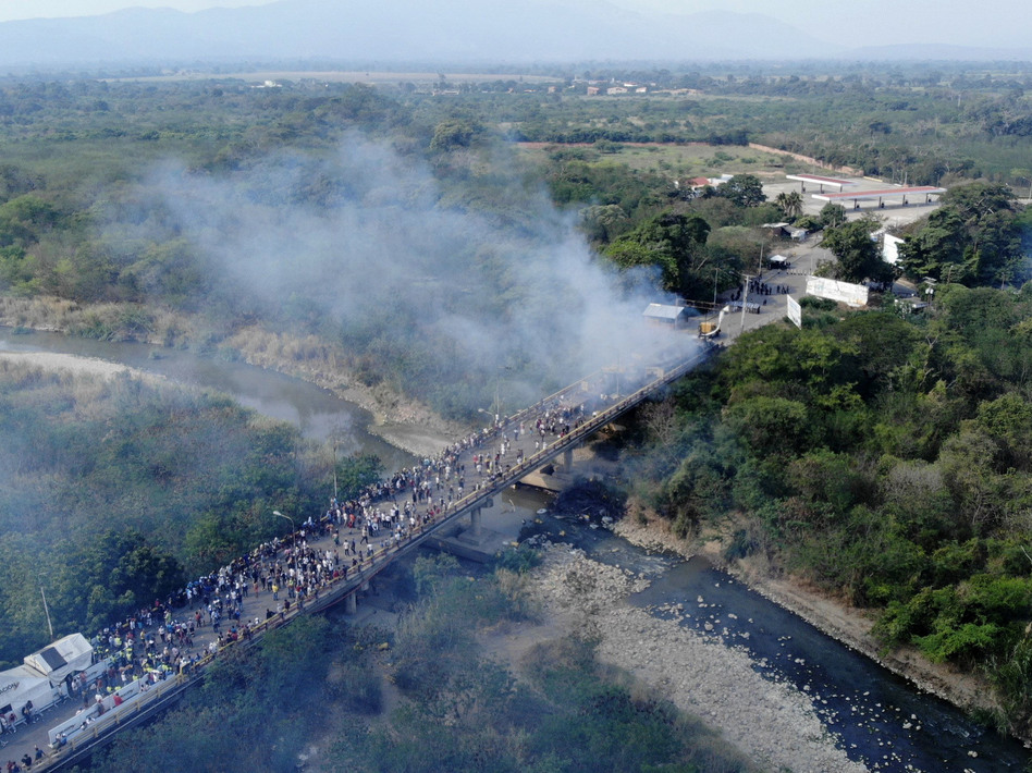 Smoke billows from aid trucks set on fire on the Francisco de Paula Santander International Bridge between Colombia and Venezuela, on Feb. 23. (Edinson Estupiñán/AFP/Getty Images)