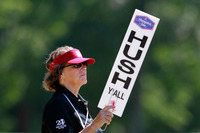 """A volunteer holds up a """"Hush Y'all"""" sign at an LPGA golf tournament in 2012 in Mobile, Ala."""