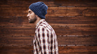 "This is the unedited version of a contested photo from an <em>MIT Technology Review</em> article on hipsters. Original caption: ""Shot of a handsome young man in trendy winter attire against a wooden background."""