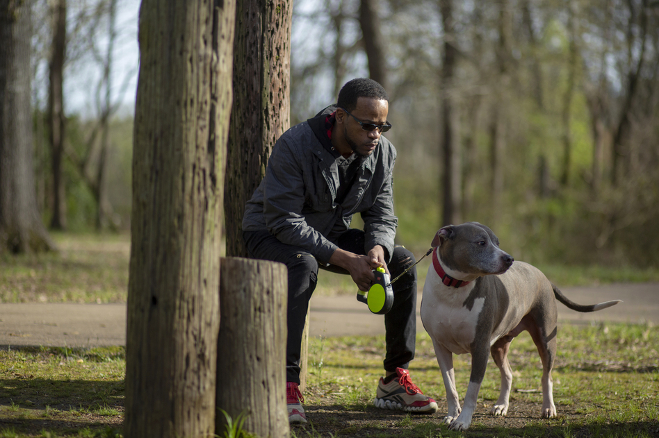 Shawn Esco brings his dog Nibbler to a park in Jackson, Miss. He was diagnosed with HIV 11 years ago and has stayed healthy, but the same can't be said of many of the other HIV-positive people in his life. (L. Kasimu Harris for NPR)