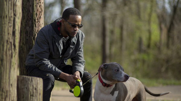 Shawn Esco brings his dog Nibbler to a park in Jackson, Miss. He