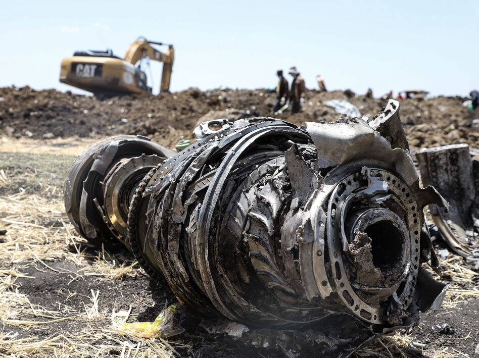 Debris from an Ethiopian Airlines Boeing 737 Max 8 jet sits in a field near Bishoftu, where the plane crashed after taking off from Ethiopia's capital city, Addis Ababa, on Sunday. (Michael Tewelde/AFP/Getty Images)