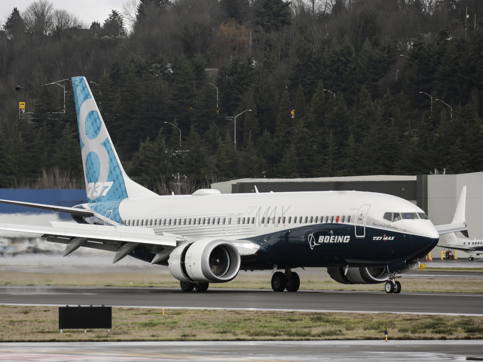 A Boeing 737 Max 8 airliner lands at Boeing Field to complete its first flight on Jan. 29, 2016, in Seattle. The Boeing 737 Max is the fastest-selling plane in the company's history. (Stephen Brashear/Getty Images)