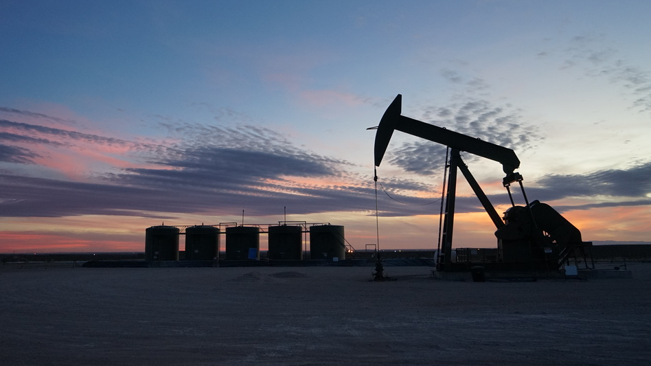 Pumpjacks like this one dot the desert of southeast New Mexico, as oil and gas companies rush to develop one of the largest oil reserves in the world. (Nathan Rott/NPR)
