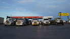 Big-rigs, destined for the oil fields, line up in the pre-dawn light at a gas station outside of Hobbs, N.M. Gas stations have had a hard time hiring enough employees to meet the demands of the oil boom.