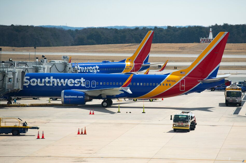 A Boeing 737 Max 8 flown by Southwest Airlines sits at the gate at Baltimore Washington International Airport on Wednesday. Per the FAA order, Southwest said it has removed its 34 Max 8s from service. (Jim Watson/AFP/Getty Images)