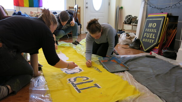 """Teenagers in Philadelphia prepare a banner for the """"U.S. Youth Climate Strike."""" Students around the world have skipped school as a protest to call for more action on climate change."""