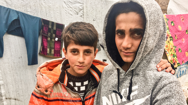 Mazen (right), 13, and his brother Mezban in a camp for displaced Yazidis in the Kurdistan region of Iraq. Mazen was freed recently, five years after being kidnapped by ISIS. He was found in Baghouz, the last ISIS stronghold in Syria. His brother was also kidnapped and, 2-1/2 years ago, was rescued with their mother. The boys
