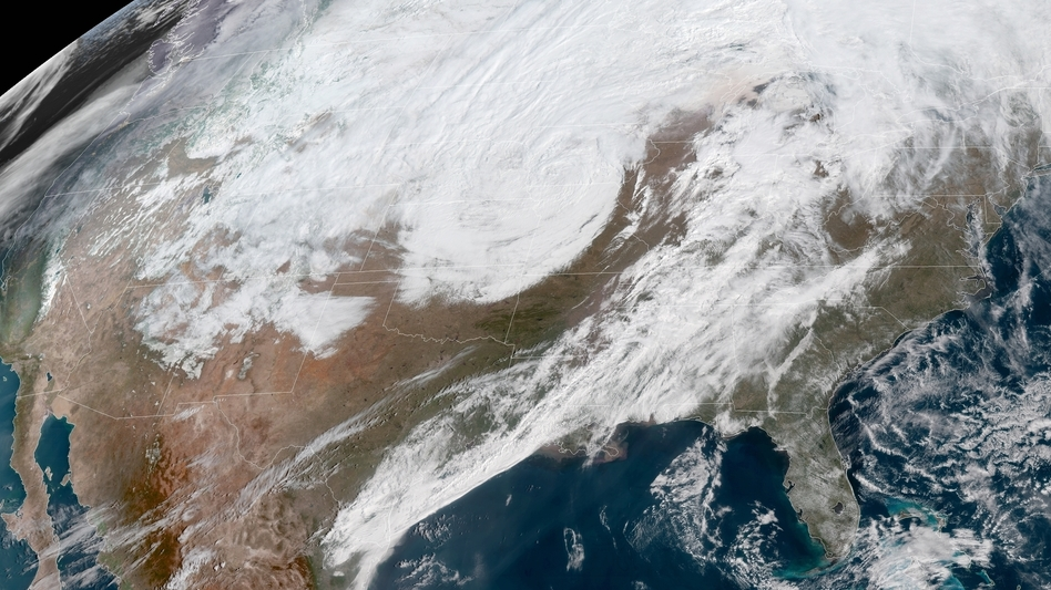 A massive late winter storm is bringing blizzard conditions to a number of central U.S. states Thursday. In affected areas, many agencies are shutting down and urging people to stay off the roads. (NASA/NOAA GOES Project)