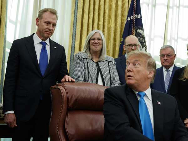 "Acting Secretary of Defense Patrick Shanahan listens as President Trump speaks during a signing event for ""Space Policy Directive 4"" in the Oval Office of the White House in February."