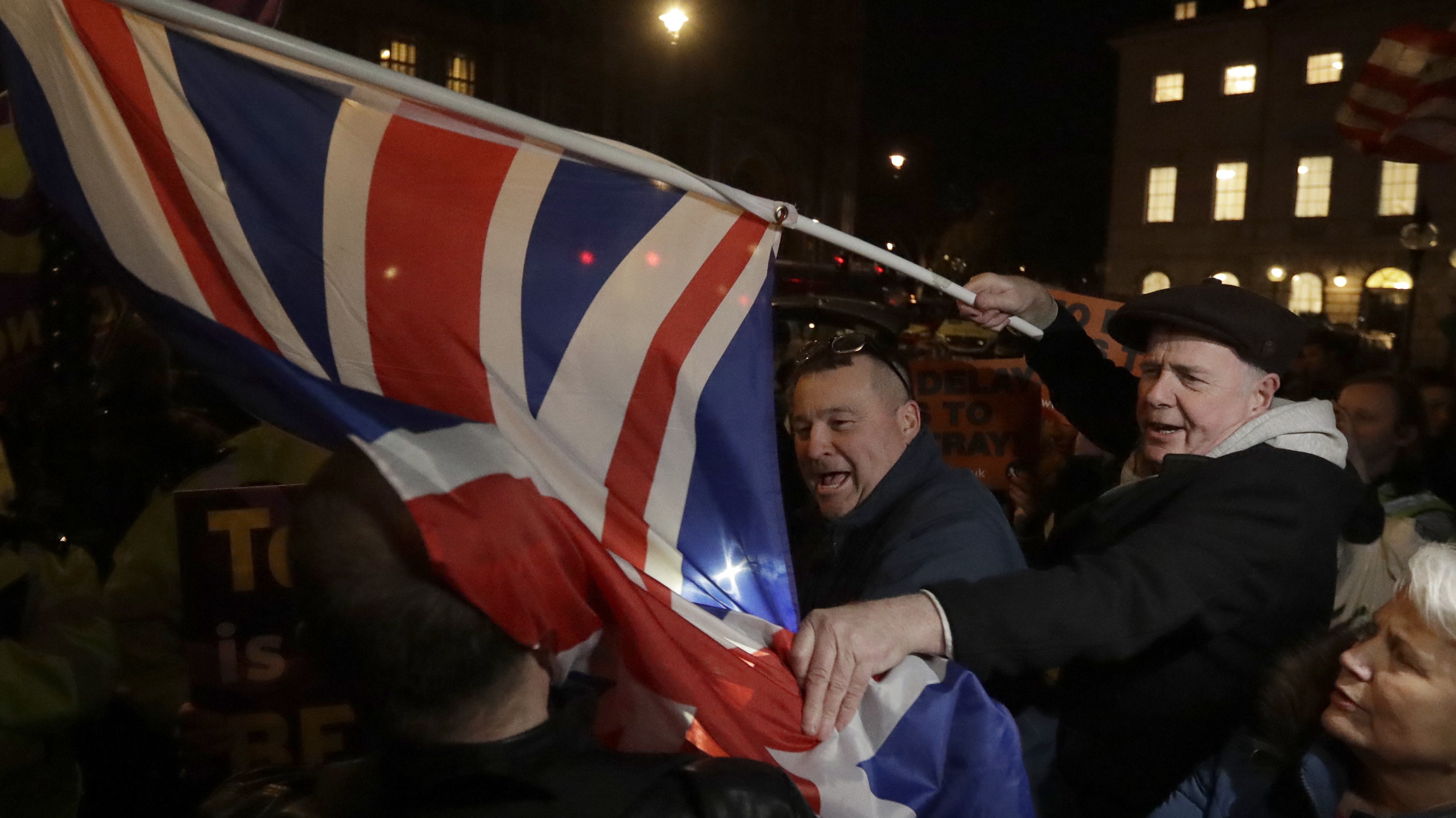 Brexit supporters and opponents shout at each other outside Parliament in London on Thursday the day that British lawmakers voted to delay Brexit