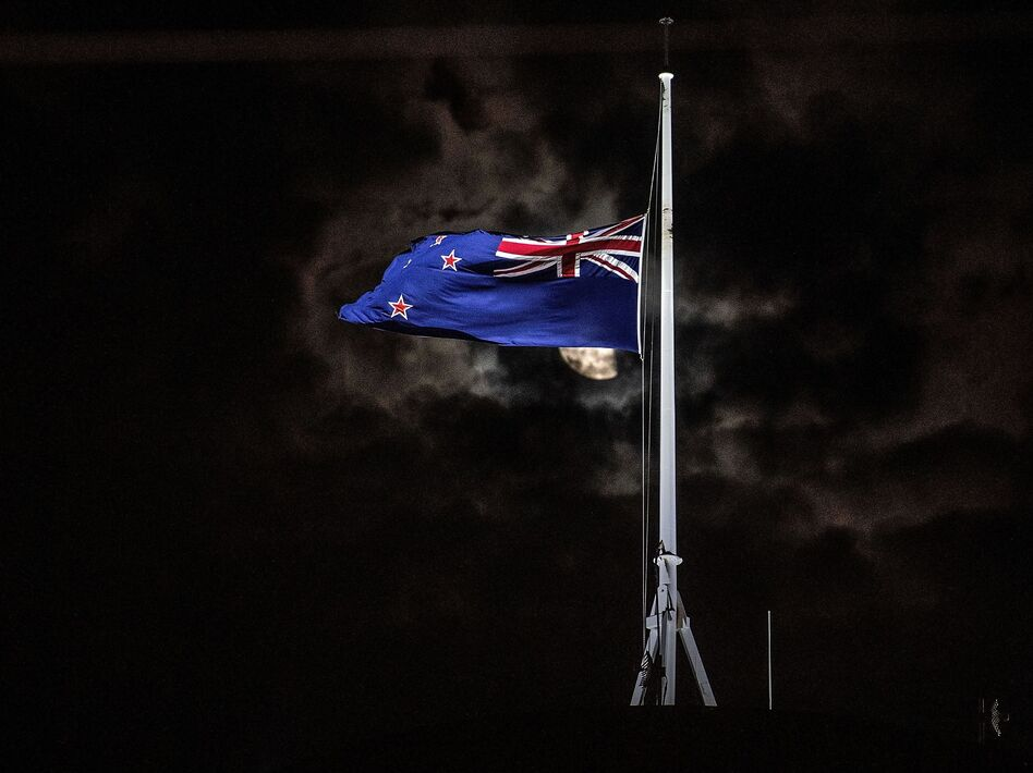New Zealand's flag is flown at half-staff on a Parliament building in Wellington on Friday after the shootings in Christchurch. (Marty Melville/AFP/Getty Images)