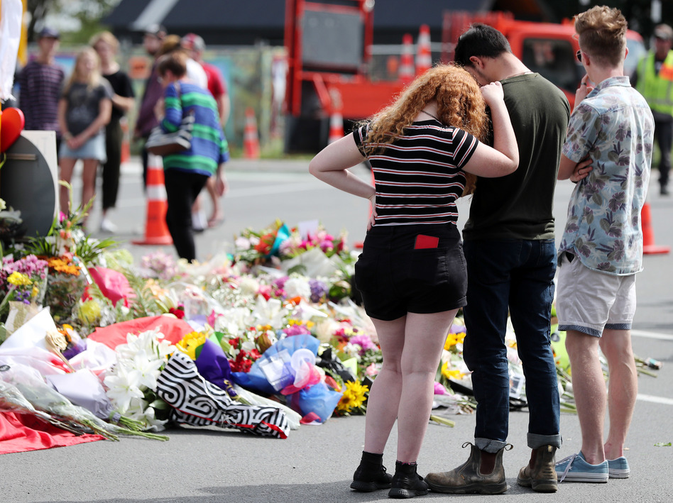 Residents pay their respects by placing flowers for the victims of the mosques attacks in Christchurch. (Michael Bradley/AFP/Getty Images)
