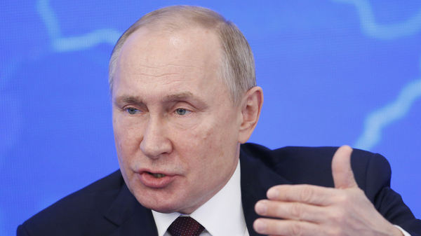 Russian President Vladimir Putin has signed a law that makes it a crime to spread online information insulting Russia