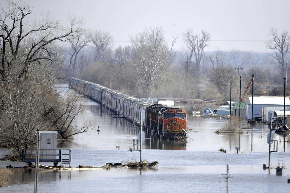 A BNSF train sits in floodwaters from the Platte River in Plattsmouth, Neb., on Sunday. Hundreds of people remained out of their homes in Nebraska as rivers began to recede. (Nati Harnik/AP)