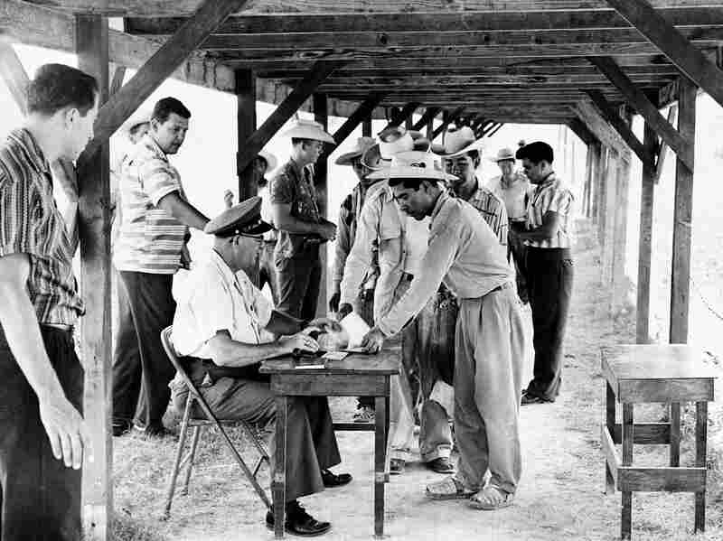 Mexican farm workers being processed at a labor center at Hidalgo, Texas, June 18, 1959. Mexican migrants had been legally coming to the U.S. with guest-worker visas since 1942 as part of the Bracero Program. It was created to address a labor shortage after the U.S. entered World War 2. More than 4.5 million Mexicans participated in the Bracero Program.