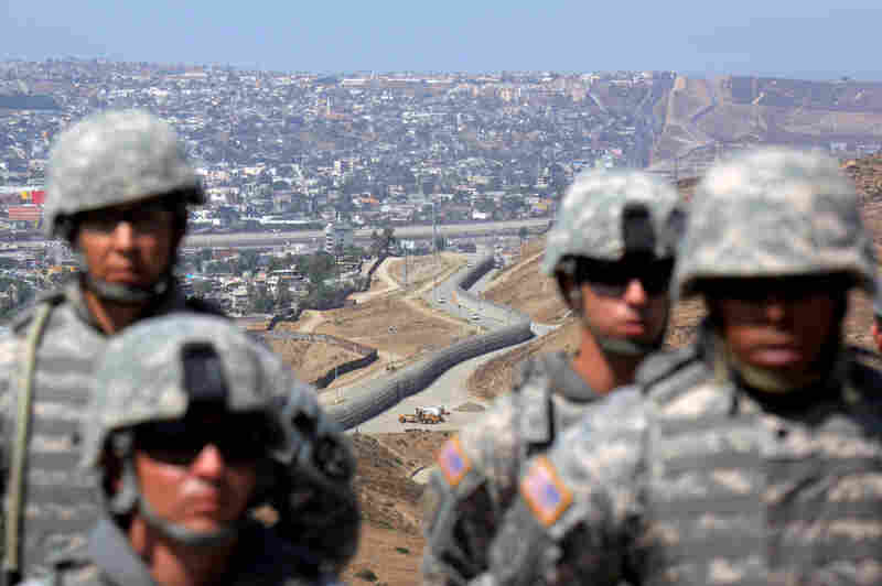 National Guard troops stand in formation along the U.S.-Mexico border in San Ysidro, California, in 2010. President Barack Obama ordered more than a thousand National Guard troops to the border in response to Border Patrol agents who were overwhelmed by drug smugglers and illegal border crossings.