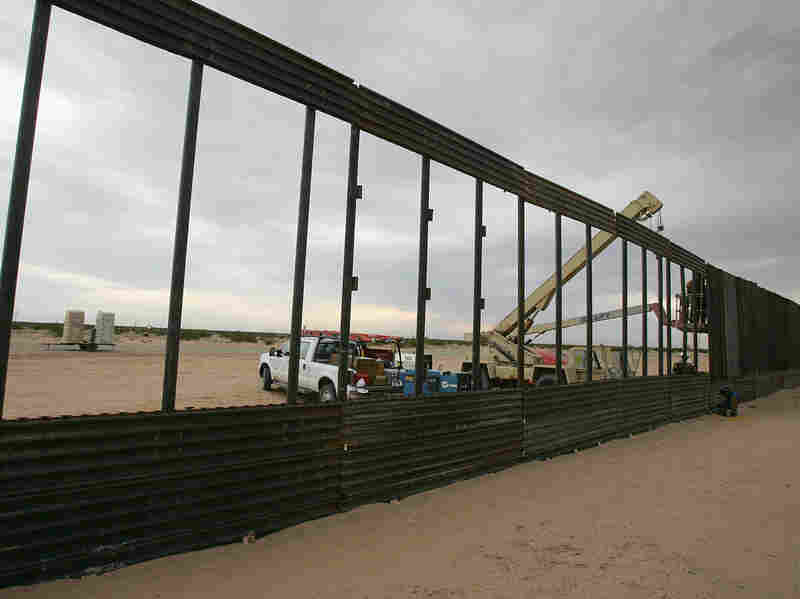 "Members of the Utah National Guard extend a wall along the US-Mexico border to prevent illegal immigration in Arizona, June 2006. This was under President George W. Bush's program, ""Operation Jump Start,"" which deployed six thousand National Guard soldiers to assist Border Patrol agents. He also signed the Secure Fence Act that authorized the construction of a 700-mile fence along the border."