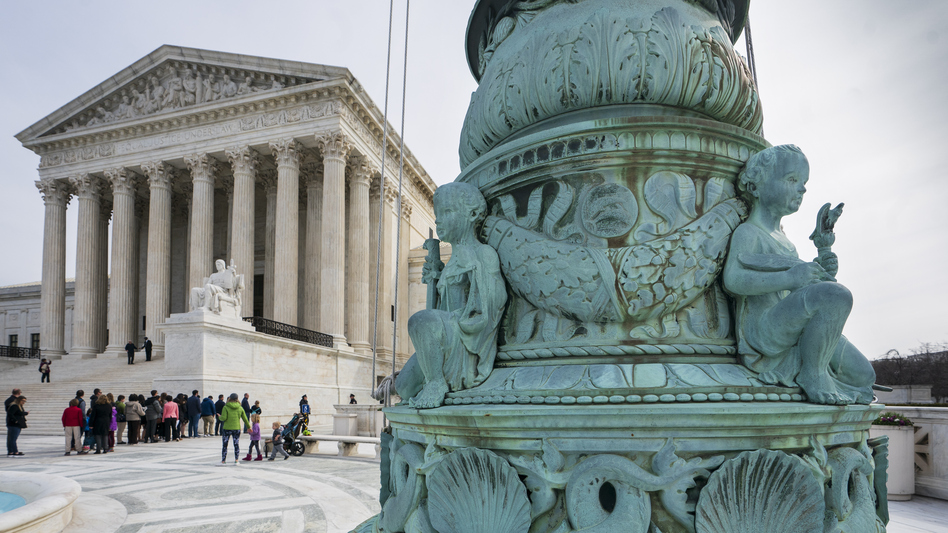 People line up to enter the Supreme Court in Washington, Wednesday. (J. Scott Applewhite/AP)