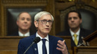 Wisconsin Gov. Tony Evers, a Democrat, delivers the State of the State address on Jan. 22. On Thursday, a Wisconsin county judge restored the governor's powers that had been restricted by Republicans during a lame-duck session.
