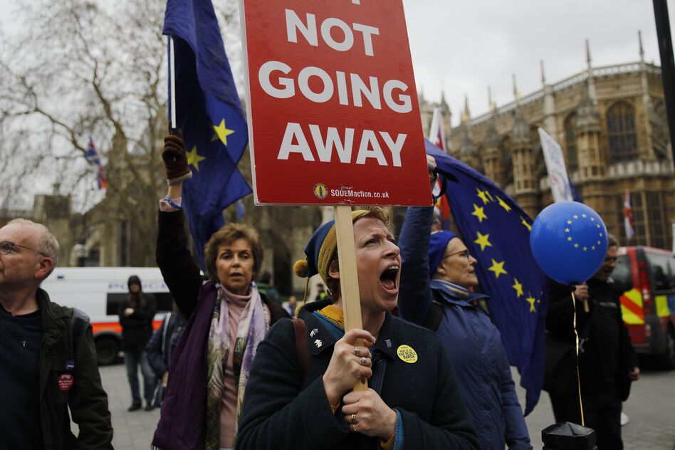 Demonstrators carry EU flags and shout slogans outside the Houses of Parliament in central London on March 21. (Tolga Akmen/AFP/Getty Images)