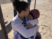Irsi Castillo of Honduras holds her 3-year-old daughter just after crossing the Rio Grande into the U.S. at El Paso, Texas. Castillo is one in the surge of thousands of migrants claiming asylum at the U.S.-Mexico border.