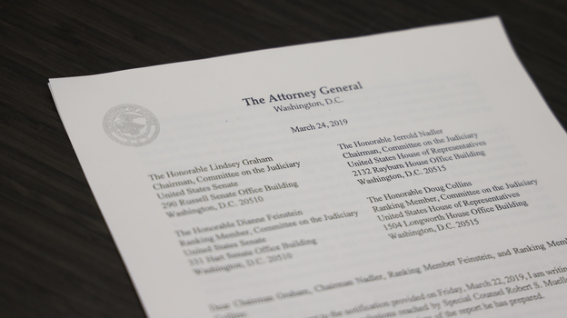 A copy of Attorney General William Barr's letter to Congress regarding the conclusion of Special Counsel Robert Mueller's investigation is arranged for a photograph in Washington, D.C.
