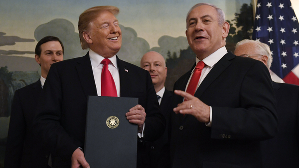 President Trump stands with Israeli Prime Minister Benjamin Netanyahu during a ceremony to sign a proclamation recognizing Israel