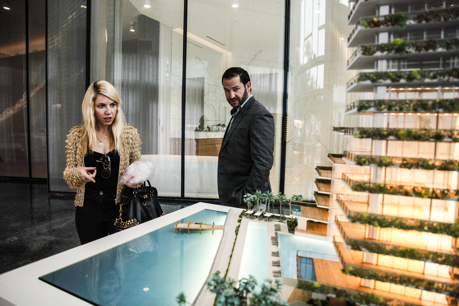 MIAMI, FL — TUESDAY, MARCH 19, 2019-- Interested buyers view the live model of Monad Terrace Luxury Development, a luxury high rise in an area of heavy infrastructural investment to protect their building from sea level rise and hurricanes Tuesday, March 19, 2019. (Maria Alejandra Cardona for NPR)
