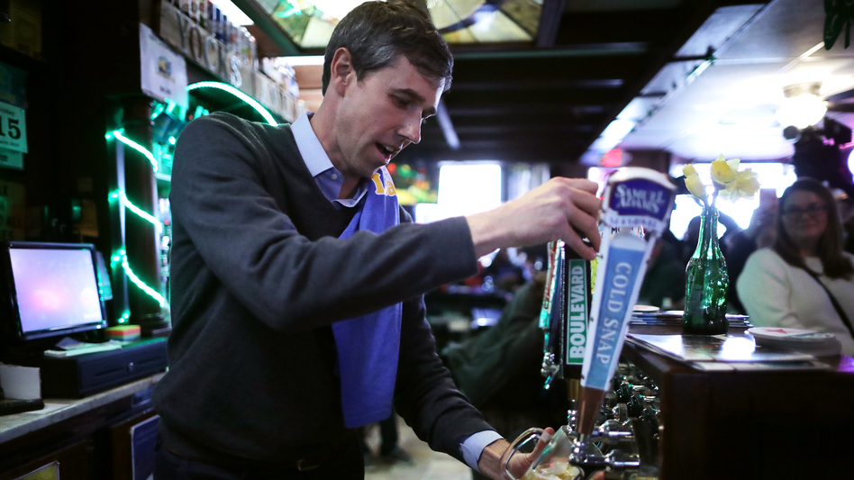 Democratic presidential candidate Beto O'Rourke pours a beer for a customer at Yock's Landing on March 15 in Mount Vernon, Iowa. (Chip Somodevilla/Getty Images)