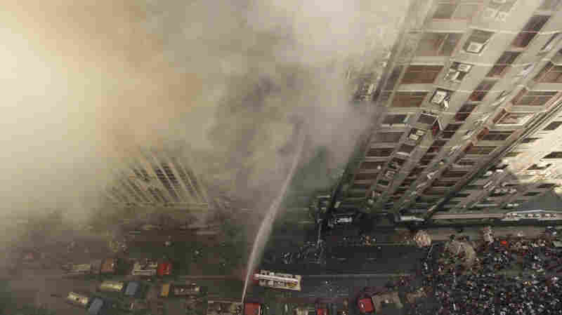 Emergency Exits Were Locked In Building Where 25 People Died From Fire, Officials Say