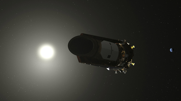 This illustration made available by NASA shows the Kepler space telescope, the planet-hunting spacecraft that launched in 2009.