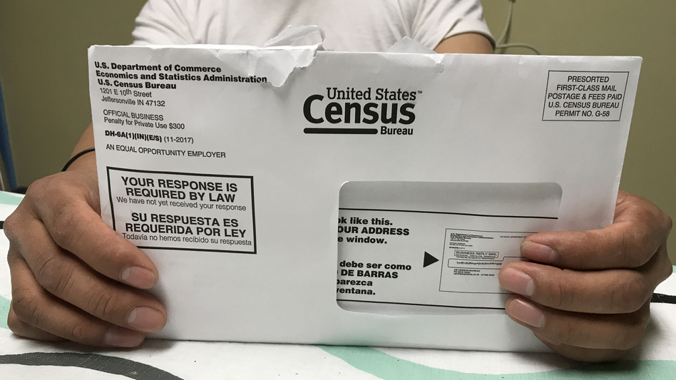 A Rhode Island resident holds an envelope he received for the 2020 census test run in Providence County. (Hansi Lo Wang/NPR)