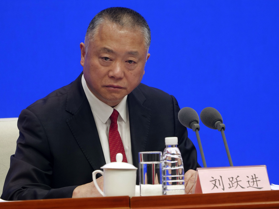 Liu Yuejin of China's National Narcotics Control Commission speaks at a Beijing press conference on Monday. He announced that all fentanyl-related drugs will become controlled substances, effective May 1. (Sam McNeil/AP)