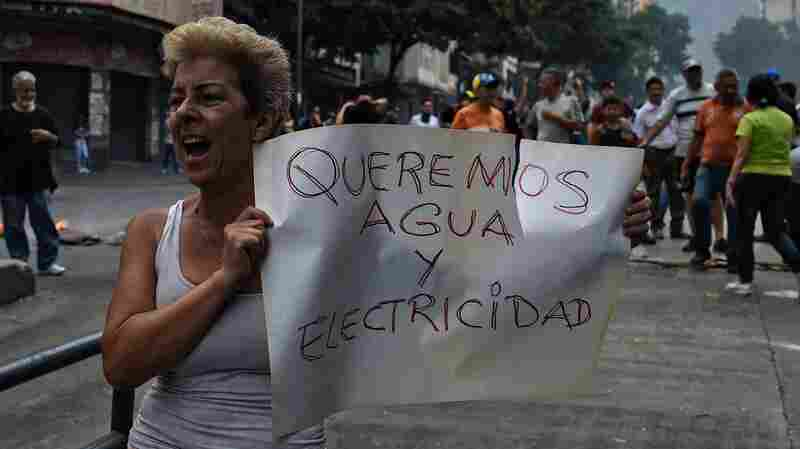 Venezuela's Maduro Institutes Plan To Ration Electricity As Outages Spur More Protest