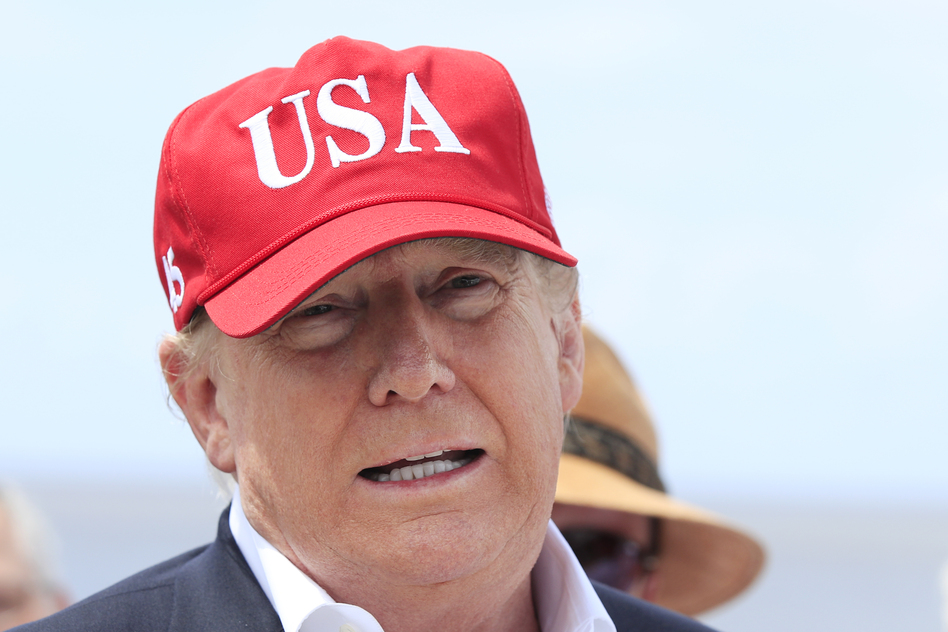 President Trump says he will close the United States' Southern border, or large sections of it, next week if Mexico does not immediately stop illegal immigration. Here Trump speaks to reporters during a visit to Lake Okeechobee and Herbert Hoover Dike at Canal Point, Fla., on Friday. (Manuel Balce Ceneta/AP)