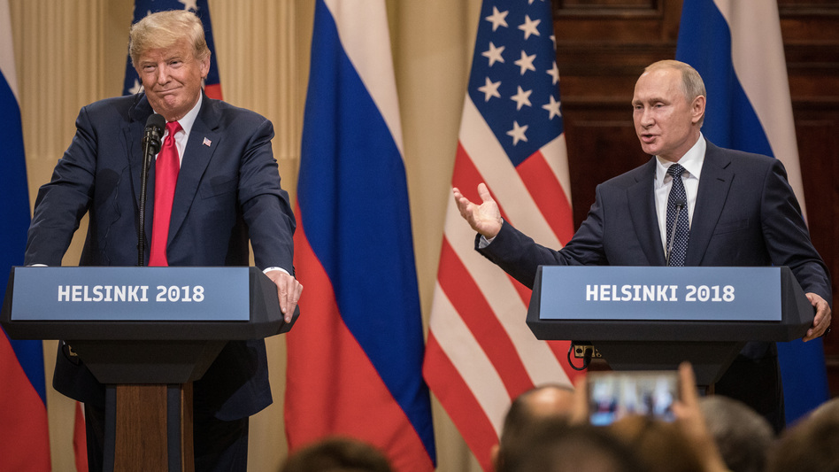 U.S. President Donald Trump and Russian President Vladimir Putin answer questions about the 2016 election during a joint press conference after their summit on July 16, 2018, in Helsinki, Finland. (Chris McGrath/Getty Images)